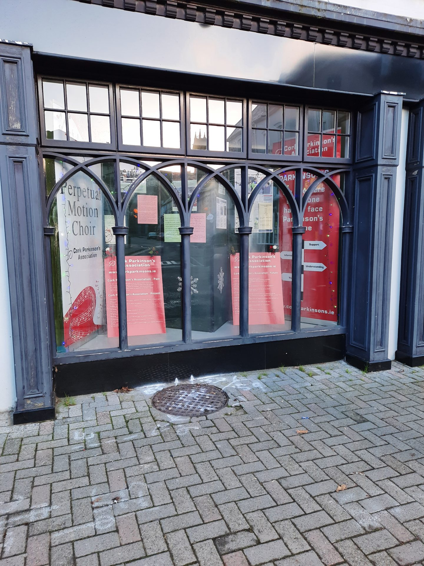 Shop window in Bandon displaying CPA banners